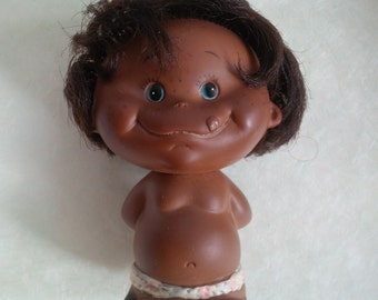 Vintage Dark brown skin boy doll holding apple - 1968 Holiday Fair Inc. Japan - rubber doll hiding red apple