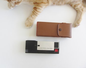 retro Electroflash 555 camera and leather case . super slim pocket gear .sale s a l e