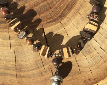 Mixed wood and seed necklace with pewter acorn pendant