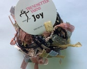 Trendsetter Joy #1134 - Meteor Shower - Yarn with Ribbon Flags of Grey, Gold, Dusty Rose, Grey-Green - 25 Gram, 62 Yards