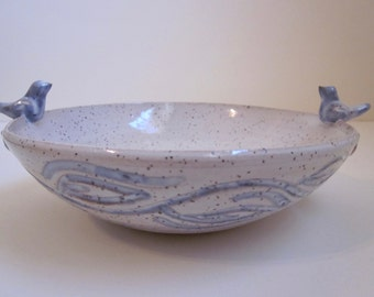 Speckled bowl with birds