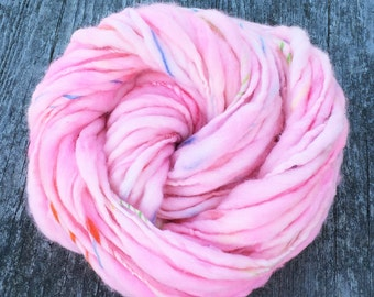 Thick and thin handspun yarn spun in merino wool, super bulky weight, 50 yards 2.7 ounces and 78 grams