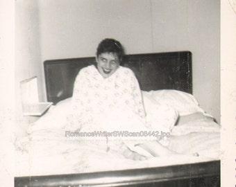 N03403 Woman sits in Bed Seductive Smile Cute Teasing Snapshot Vintage Photo