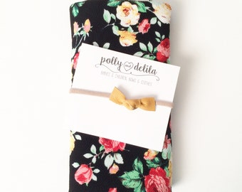 Baby girl swaddle blanket and bow headband set. Black and fall floral.