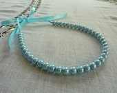 Light blue Pearls necklace with Blue Ribbon