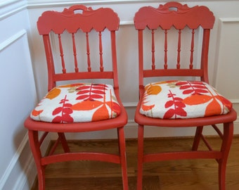 A Pair of hand painted coral red chairs