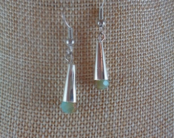 Silver cone earrings with pale green iridescent beads