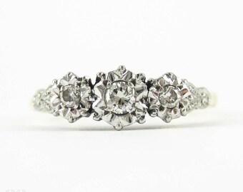 Art Deco Trilogy Engagement Ring, 0.25 ctw Three Stone Round Brilliant Diamond Ring. Circa 1930s, 18 ct & Platinum.