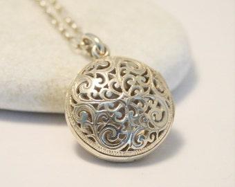 Vintage sterling silver locket.  Pierced locket.  Fretwork locket.  Locket on chain