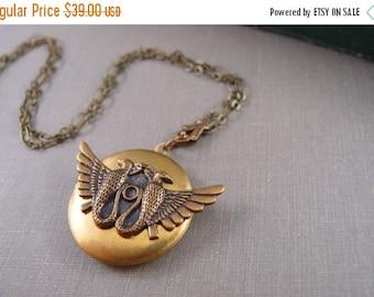CLEAROUT SALE 40% OFF Egyptian Horus Bird goddess vintage locket, aged brass locket, round locket, L087