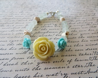 Ivory And Aqua Resin Roses With Frosted Glass And Howlite Skull Beads Bracelet