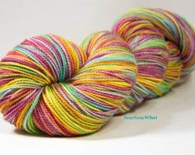 "Hand dyed yarn. ""Paradise City"" Fingering weight yarn. Sock yarn."