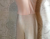 RESREVED dont not buy 1970 vintage, disco, cream, lurex and knit flarelegged jumpsuit womens small/ medium.
