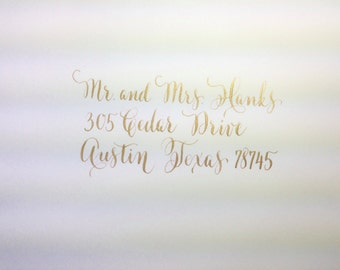 Modern flourished calligraphy addressing envelope