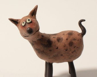TOMTOM pet sculpture