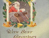 Santa in his Sleigh Inside Holly Wreath and Large White Bright Candles Vintage Christmas Postcard 1907