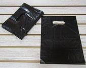 100 Black Plastic Merchandise Bags (9 x 12 in.)