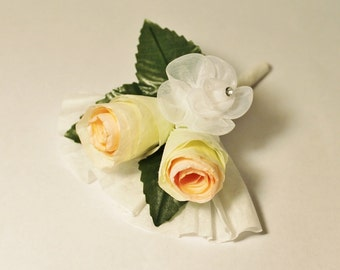 Paper And Silk Flower Corsage in soft yellow, peachy pink and white