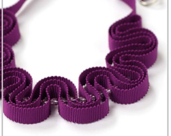 Purple ribbon necklace with glass beads
