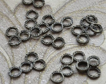 20 pcs of Antique bronze Twine 8 fancy jumpring ,metal bead,loose round rings beads,finding 9mm
