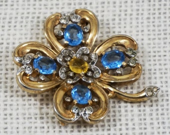 Vintage Crown Trifari Alfred Philippe Gold Tone Four Leaf Clover Light Blue and Citrine Yellow Rhinestone Pin Brooch