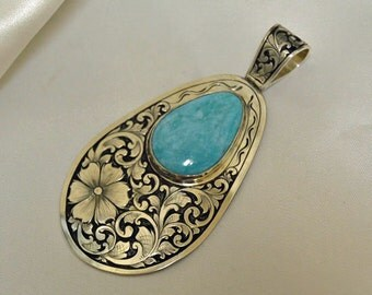Sterling Silver engraved pendant with Turquoise cab