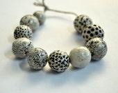 Ways to die in space -- 10 b&w ceramic art beads