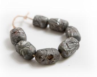 Seeds of a singularity --  7 textured raku barrel beads