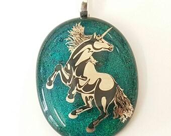 Black and silver enamel Unicorn on green dichroic glass pendant.