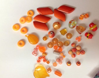 59 Orange Beads plus a bag of micro beads ... destash sale ...  different shades of Orange, shapes and sizes vary  ...  Beads As Shown