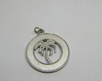 Vintage Silver Chrome Round Pendant with a Palm Tree