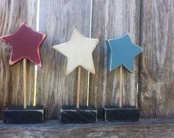 Set of three red, white and blue shelf sitter stars