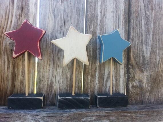 Set of three red, white and blue shelf sitter stars