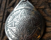 Moroccan cushion hand engraved pendant with four point star