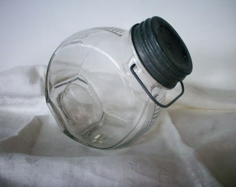 Vintage Tilted Glass Jar with a Wire Bale and Ball Zinc Lid
