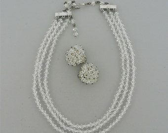Laguna Crystal Three Strand Necklace and Clip-On Earring Set.