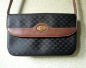 Gucci Shoulder Bag clutch purse crossbody long strap designer handbag brown leather black monogram canvas elegant hipster vintage 70s 80s
