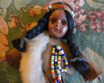 VINTAGE Native American Indian Costume Doll - Girl, brown suede fringed top, fringed pants, shoes & beaded headband, bead neckware, faux fur