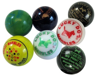 "Vintage 7 colored Marbles advertising marbles 1"" marbles yellow, white,black, green."