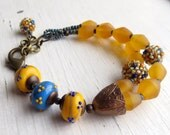 Lemon Grove - handmade bead bracelet in lemon yellow and blue with artisan lampwork+handwoven glass, resin - Songbead UK, narrative jewelry