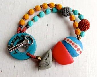 Live Bravely - handmade bracelet, turquoise bracelet, bead bracelet, orange bracelet, cobalt jewellery, bird jewellery, songbead, uk
