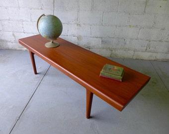 Long Teak mid century Modern styled COFFEE TABLE cubbies