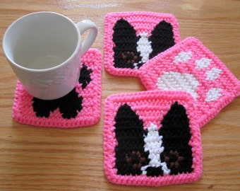 Boston Terrier Coasters. Neon pink crochet coaster set with peeking Boston dogs and paw prints. Dog cup cozie
