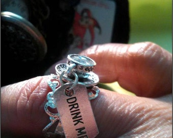 Alice in Wonderland Ring Mad Hatter Tea Party Tea Duel Tiffin Mistress ring with DRINK ME tag