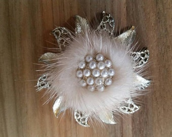 A vintage mink and pearl brooch