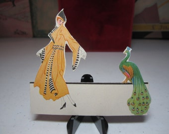 Unused 1910's-20's Chas. S. Clark die cut place card colorful graphics of gorgeous dressed up lady looking at a beautiful peacock