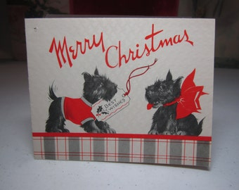Art deco 1930's-40's christmas card scotty dog in sweater gives scotty wearing a red ribbon a card, giant snowball inside