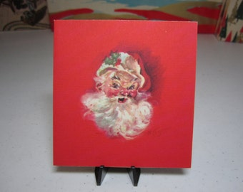 1940's Marjorie Cooper Rust craft christmas card with santa claus St. nick graphics