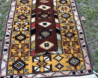 Vintage Tribal Rug with a Rich Brown Field
