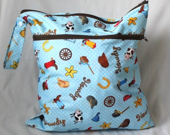 Wet and dry bag. Double zippered bag. 2 compartments. cow boy Print Large 14x16 will fit approx 10-12 diapers